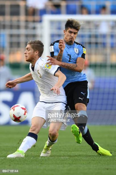 Italy's defender Filippo Romagna and Uruguay's forward Joaquin Ardaiz compete for the ball during the U20 World Cup third place playoff football...