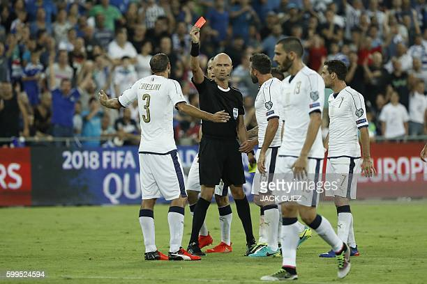 Italy's defender Giorgio Chellini receives a red card during the World Cup 2018 qualifier football match Israel vs Italy at Sammy Ofer Stadium in...