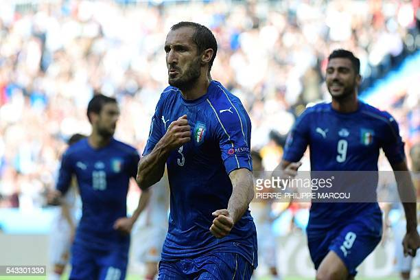Italy's defender Giorgio Chiellini celebrates scoring the opening goal during the Euro 2016 round of 16 football match between Italy and Spain at the...