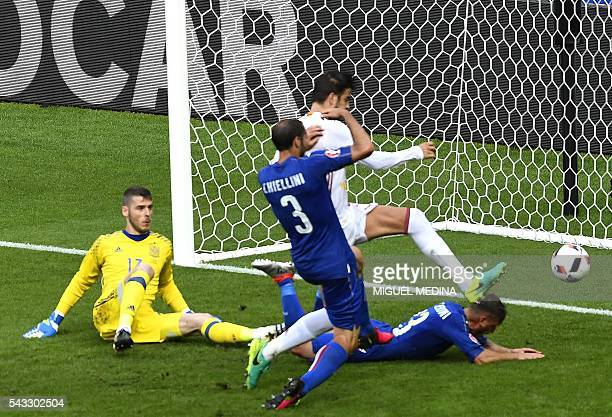 Italy's defender Giorgio Chiellini scores a goal beside Spain's goalkeeper David De Gea during Euro 2016 round of 16 football match between Italy and...