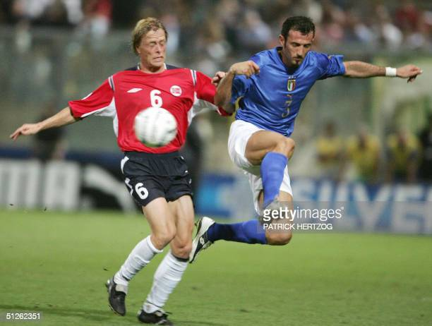 Italy's defender Giuseppe Favalli vies with Norway's midfielder Jan Derek Sorensen during their World Cup 2006 qualifying football match at Renzo...