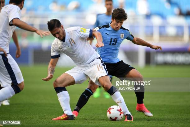 Italy's defender Giuseppe Pezzella and Uruguay's forward Agustin Canobbio compete for the ball during the U20 World Cup third place playoff football...