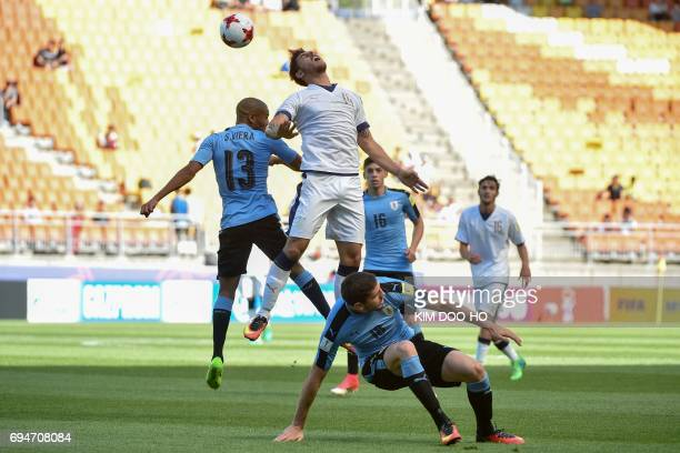 Italy's defender Giuseppe Pezzella and Uruguay's midfielder Santiago Viera compete for the ball during the U20 World Cup third place playoff football...