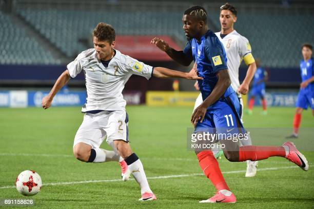 Italy's defender Giuseppe Scalera fights for the ball with France's forward Marcus Thuram during their U20 World Cup round of 16 football match...