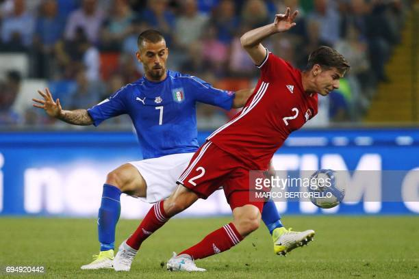Italy's defender Leonardo Spinazzola fights for the ball with Liechtenstein's midfielder Daniel Brandle during the FIFA World Cup 2018 qualification...