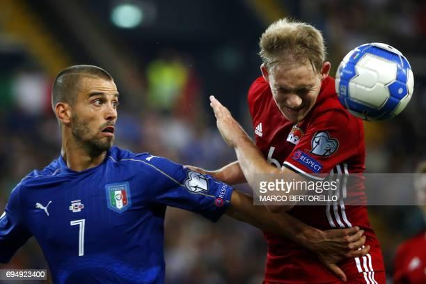 Italy's defender Leonardo Spinazzola fights for the ball with Liechtenstein's defender Martin Rechsteiner during the FIFA World Cup 2018...
