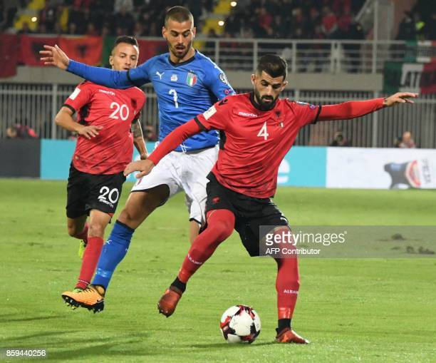 Italy's defender Leonardo Spinazzola vies with Albania's defender Eseid Hysaj during the FIFA World Cup 2018 qualification football match between...