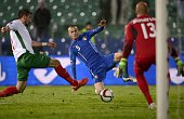 Italy's Defender Luca Antonelli vies for the ball with Bulgaria's Midfielder Stanislav Milanov during the EURO 2016 Group H match between Bulgaria...
