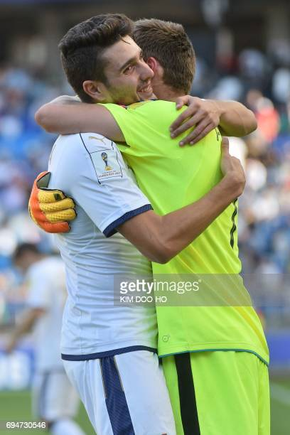 Italy's defender Riccardo Marchizza and Italy's goalkeeper Alessandro Plizzari celebrate their victory during the U20 World Cup third place playoff...