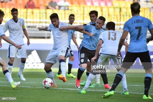 Italy's defender Riccardo Marchizza and Uruguay's forward Rodrigo Amaral compete for the ball during the U20 World Cup third place playoff football...