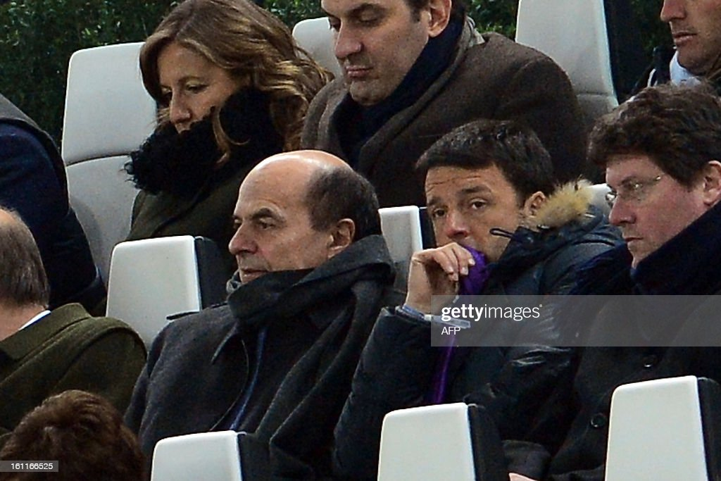 Italy's Democratic party leader Pierluigi Bersani (L) and Florence's Mayor Matteo Renzi attend an Italian Serie A football match between Juventus and Fiorentina at the Juventus Stadium in Turin on February 9, 2013.
