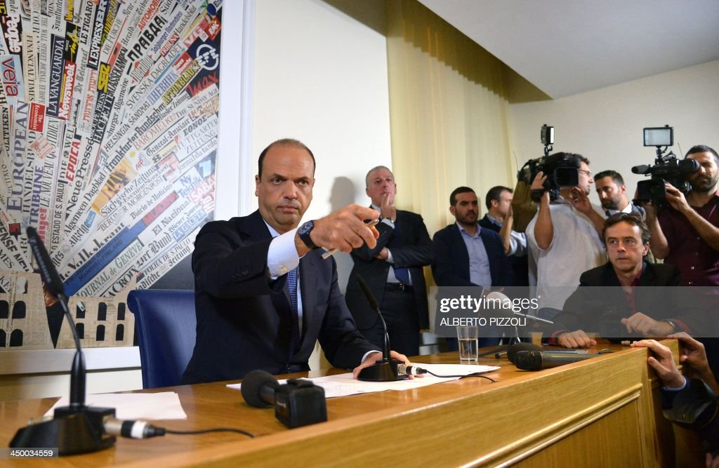 Italy's deputy prime minister Angelino Alfano (L) gestures during a press conference in Rome on November 16, 2013. Silvio Berlusconi's centre-right party has split, in the latest blow for the scandal-tainted billionaire ex-premier, who may be voted out of parliament at the end of the month. Alfano, Berlusconi's former right-hand man, announced he would not remain at the side of his onetime mentor and would form his own party instead. AFP PHOTO / ALBERTO PIZZOLI