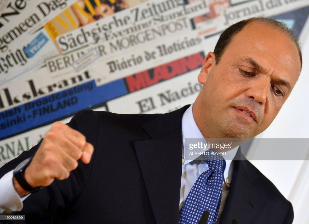 Italy's deputy prime minister Angelino Alfano gestures during a press conference in Rome on November 16, 2013. Silvio Berlusconi's centre-right party has split, in the latest blow for the scandal-tainted billionaire ex-premier, who may be voted out of parliament at the end of the month. Alfano, Berlusconi's former right-hand man, announced he would not remain at the side of his onetime mentor and would form his own party instead.