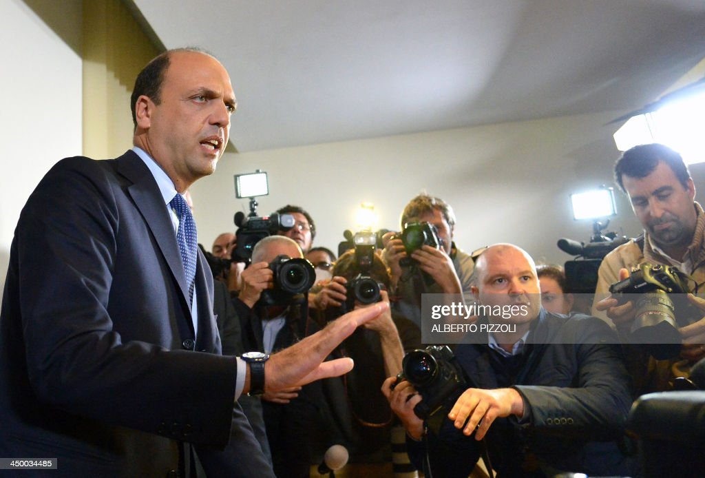 Italy's deputy prime minister Angelino Alfano (L) holds a press conference in Rome on November 16, 2013. Silvio Berlusconi's centre-right party has split, in the latest blow for the scandal-tainted billionaire ex-premier, who may be voted out of parliament at the end of the month. Alfano, Berlusconi's former right-hand man, announced he would not remain at the side of his onetime mentor and would form his own party instead.