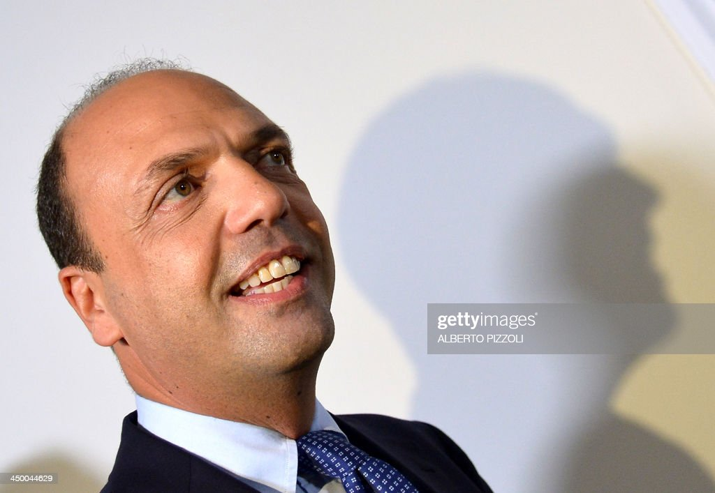 Italy's deputy prime minister Angelino Alfano smiles as he arrives for a press conference in Rome on November 16, 2013. Silvio Berlusconi's centre-right party has split, in the latest blow for the scandal-tainted billionaire ex-premier, who may be voted out of parliament at the end of the month. Alfano, Berlusconi's former right-hand man, announced he would not remain at the side of his onetime mentor and would form his own party instead.