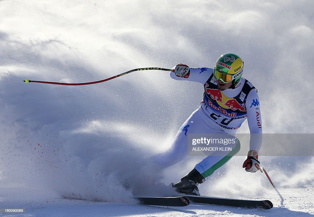 Italy's Dominik Paris arrives in the finish area after competing to win in the FIS World Cup men's downhill race on January 26, 2013 in Kitzbuehel, Austrian Alps. Italy's Dominik Paris won the event, Canada's Erik Guay finished second and Austria's Hannes Reichelt third. AFP PHOTO / ALEXANDER KLEIN