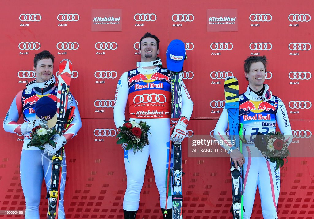 Italy's Dominik Paris (C), Canada's Erik Guay (L) and Austria's Hannes Reichelt (R) pose on the podium after the FIS World Cup men's downhill race on January 26, 2013 in Kitzbuehel, Austrian Alps. Italy's Dominik Paris won the event, Canada's Erik Guay finished second and Austria's Hannes Reichelt third.v