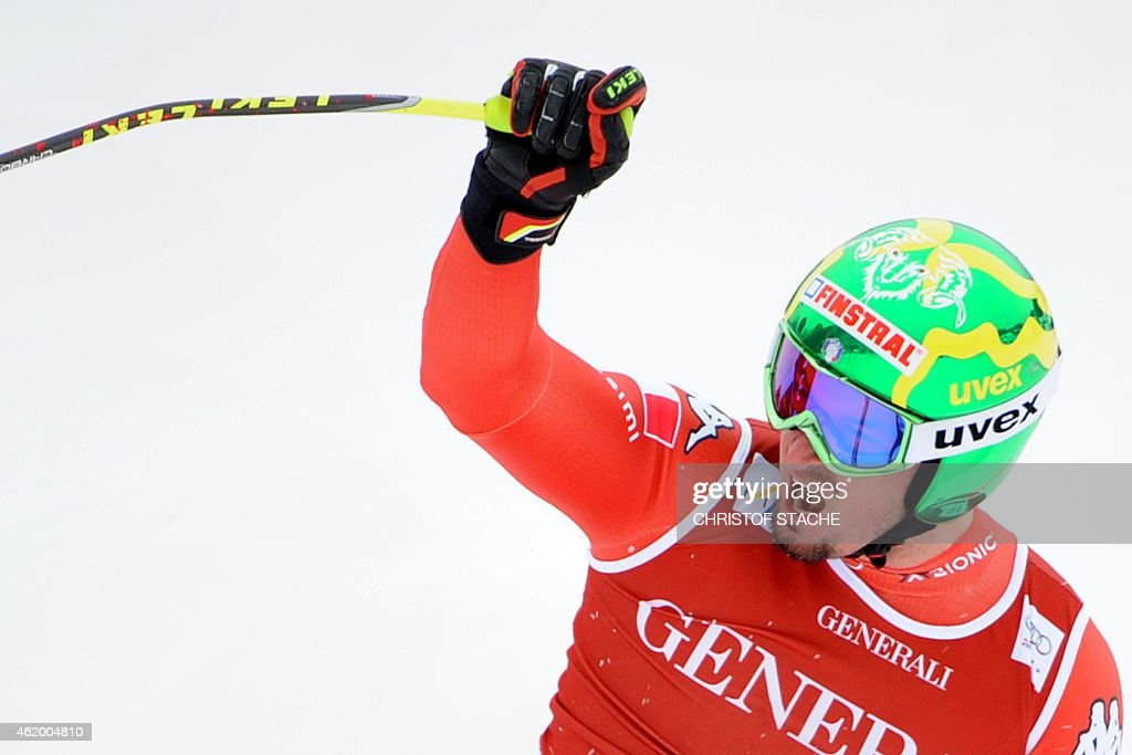 Italy's <a gi-track='captionPersonalityLinkClicked' href=/galleries/search?phrase=Dominik+Paris&family=editorial&specificpeople=5663630 ng-click='$event.stopPropagation()'>Dominik Paris</a> celebrates in the finish area after the men's downhill Super G race of the FIS Alpine Skiing World Cup in Kitzbuehel, Austria, on January 23, 2015. AFP PHOTO / CHRISTOF STACHE