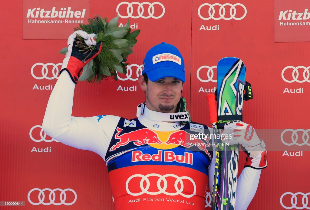 Italy's Dominik Paris celebrates on the podium after winning the FIS World Cup men's downhill race on January 26, 2013 in Kitzbuehel, Austrian Alps.