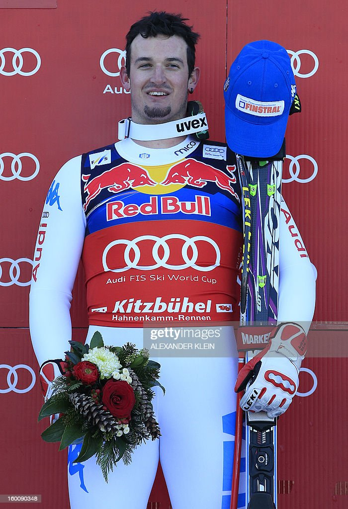 Italy's Dominik Paris poses on the podium after winning the FIS World Cup men's downhill race on January 26, 2013 in Kitzbuehel, Austrian Alps.