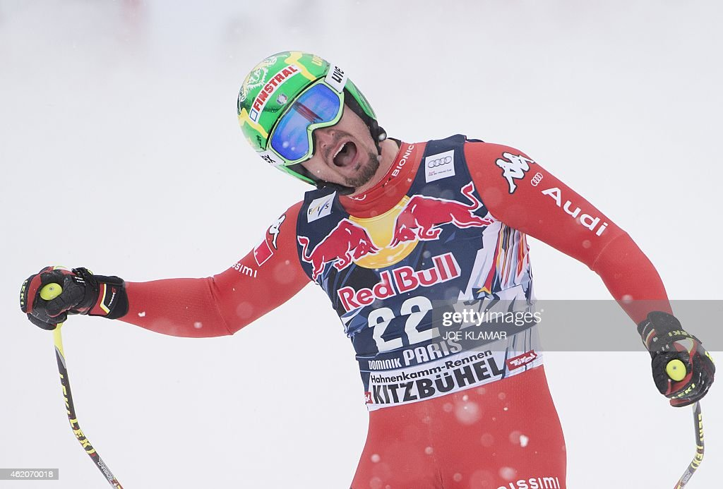 Italy's Dominik Paris reacts after placing second in the men's downhill competition of the FIS Alpine Skiing World Cup in Kitzbuehel, Austria, on January 24, 2015. AFP PHOTO / JOE KLAMAR