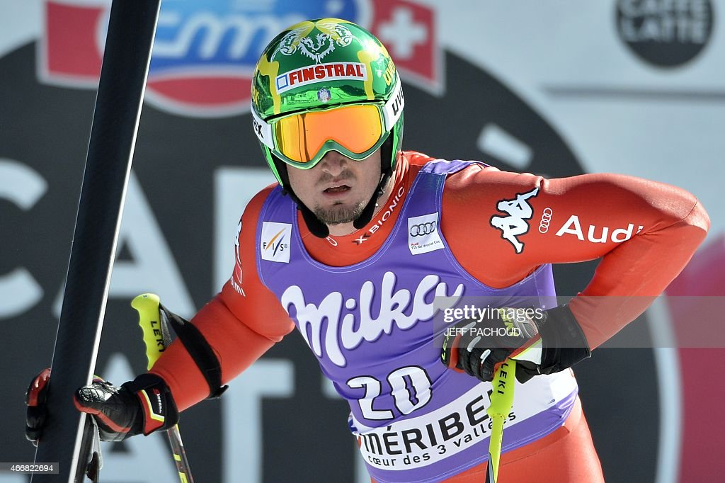 Italy's Dominik Paris reacts after taking part in the Men's Super G race at the FIS Alpine Skiing World Cup finals in Meribel on March 19, 2015. AFP PHOTO / JEFF PACHOUD