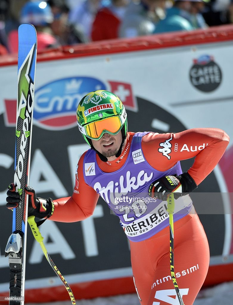 Italy's <a gi-track='captionPersonalityLinkClicked' href=/galleries/search?phrase=Dominik+Paris&family=editorial&specificpeople=5663630 ng-click='$event.stopPropagation()'>Dominik Paris</a> reacts after the Men's Super G race at the FIS Alpine Skiing World Cup finals in Meribel on March 19, 2015. AFP PHOTO / JEFF PACHOUD