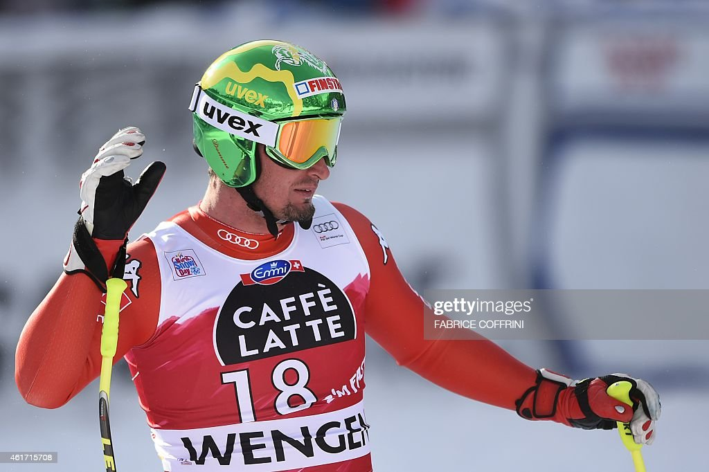 Italy's Dominik Paris reacts during the FIS Alpine Ski World Cup Men's Downhill in Wengen on January 18, 2015. AFP PHOTO / FABRICE COFFRINI
