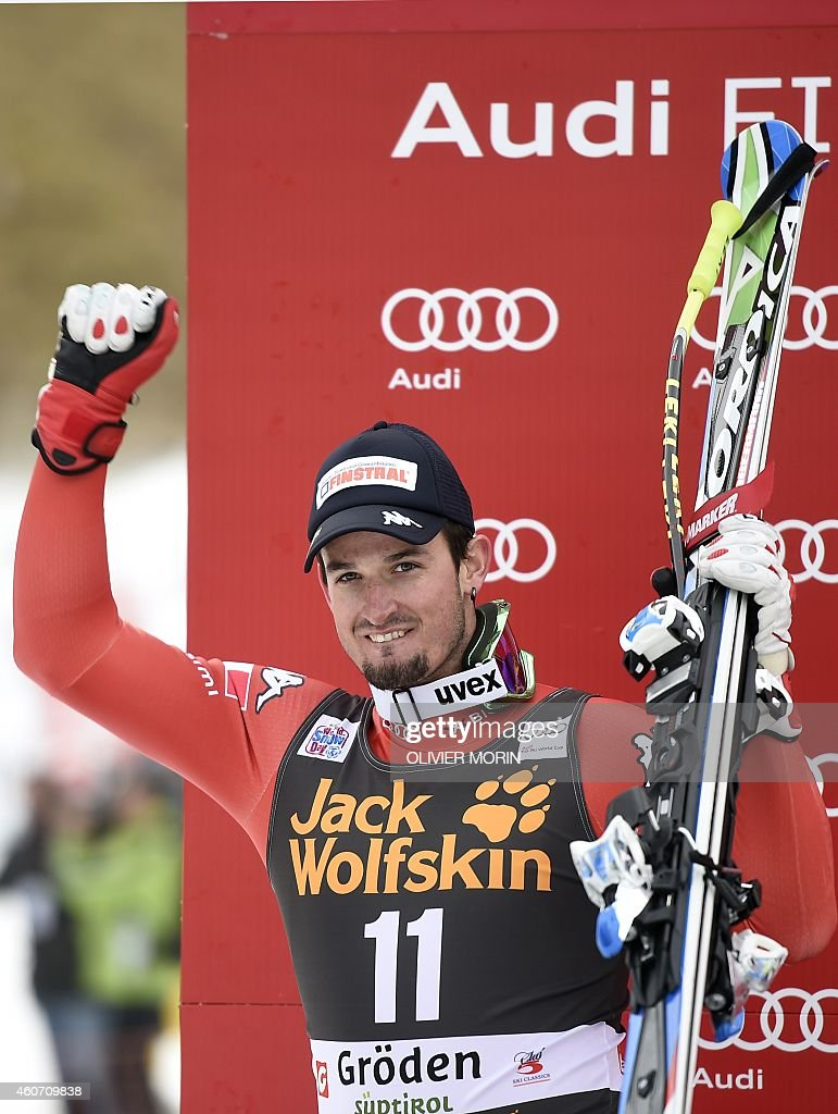 Italy's Dominik Paris, Second-placed celebrates on the podium after the mens Super G at the FIS Alpine Skiing World Cup in Val Gardena on December 20, 2014. Norway's Kjetil Jansrud won the race, ahead of Dominik Paris and Hannes Reichelt. AFP PHOTO / OLVIER MORIN