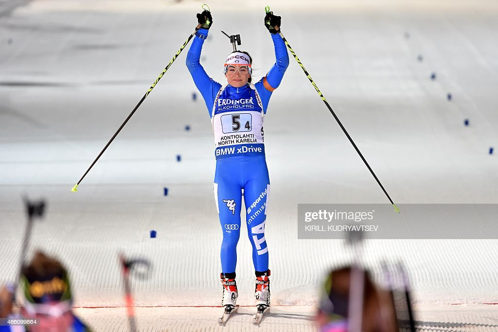 Italy's <a gi-track='captionPersonalityLinkClicked' href=/galleries/search?phrase=Dorothea+Wierer&family=editorial&specificpeople=7438920 ng-click='$event.stopPropagation()'>Dorothea Wierer</a> reacts after the Women 4x6 Relay at the IBU Biathlon World Championship in Kontiolahti, Finland on March 13, 2015. Germany's Germany's team won the competition, France's team placed second and Italy placed third. AFP PHOTO / KIRILL KUDRYAVTSEV