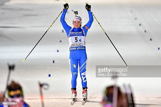 Italy's Dorothea Wierer reacts after the Women 4x6 Relay at the IBU Biathlon World Championship in Kontiolahti Finland on March 13 2015 Germany's...
