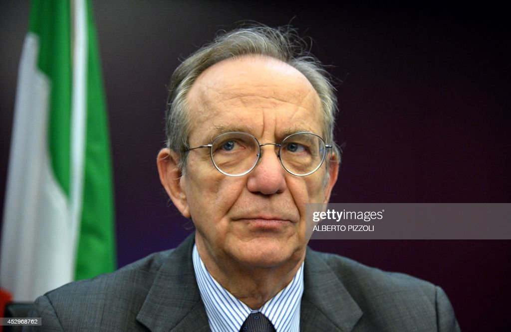 Italy's Economy and Finance Minister Pier Carlo Padoan looks on during a press conference with French Finance and Public Accounts Minister on July 31...