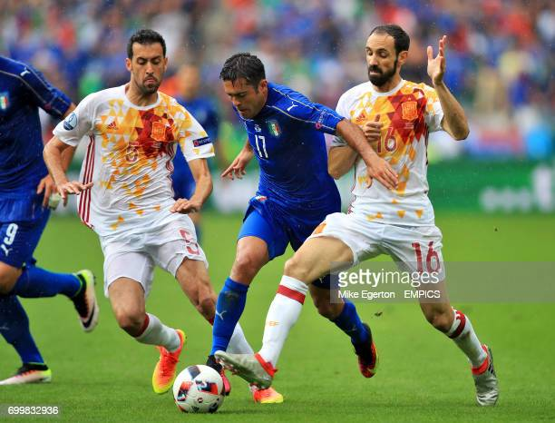 Italy's Eder battles for the ball with Spain's Sergio Busquets and Juanfran
