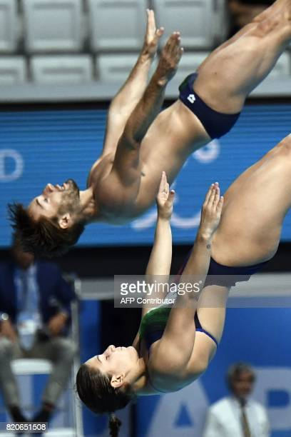 Italy's Elena Bertocchi and Italy's Maicol Verzotto compete in the Mixed 3m synchro springboard final during the diving competition at the 2017 FINA...