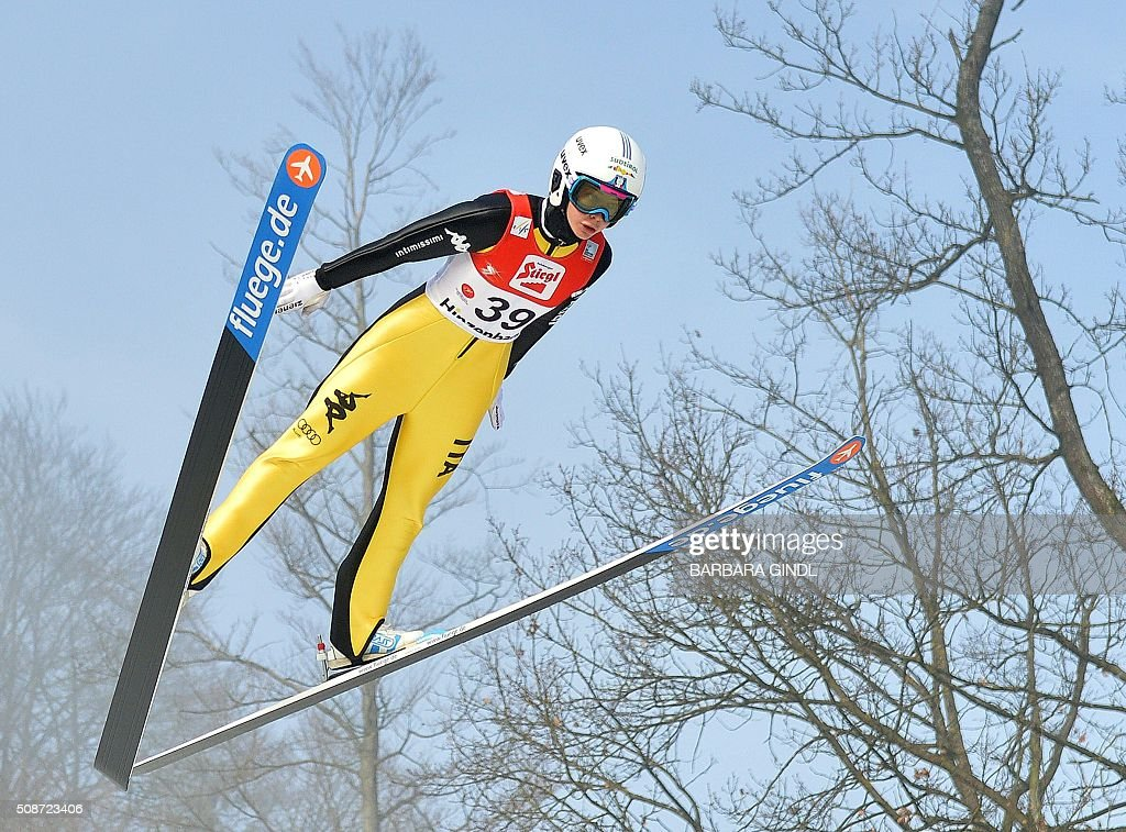 Italy's Elena Runggaldier jumps during the qualifying round of the women's ski jumping world cup in Hinzenbach, Upper Austria, on February 6, 2016. / AFP / APA / BARBARA GINDL / Austria OUT