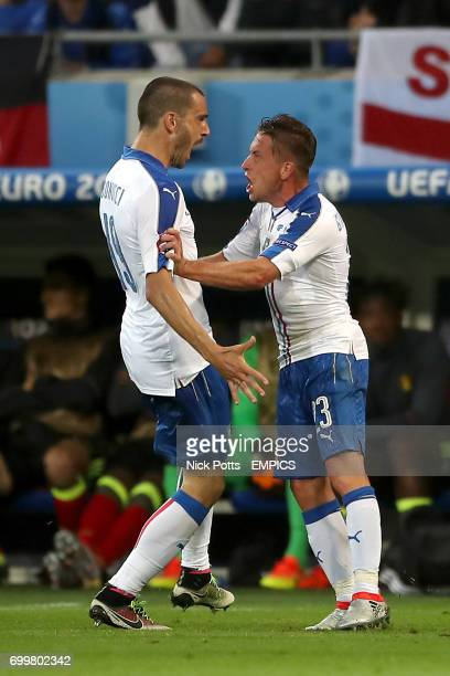 Italy's Emanuele Giaccherini celebrates scoring his sides second goal of the game with teammate Leonardo Bonucci