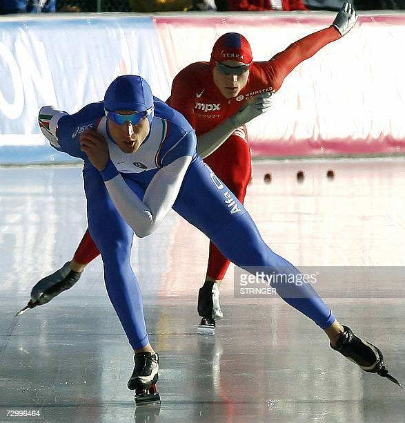Italy's Enrico Fabris and Norway's Harvard Bokko skate in the Men's 10000M competition during the European Speed Skating Championships 14 January...