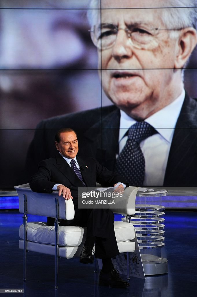 Italy's ex Prime Minister <a gi-track='captionPersonalityLinkClicked' href=/galleries/search?phrase=Silvio+Berlusconi&family=editorial&specificpeople=201842 ng-click='$event.stopPropagation()'>Silvio Berlusconi</a> attends the RAI television show 'Porta a Porta' (Door to Door) in Rome, Italy on January 9, 2013. <a gi-track='captionPersonalityLinkClicked' href=/galleries/search?phrase=Silvio+Berlusconi&family=editorial&specificpeople=201842 ng-click='$event.stopPropagation()'>Silvio Berlusconi</a> withdrew as candidate for Italy's premiership.(on the screen behind : Mario Monti) Photo by Guido Marzilla/Gamma