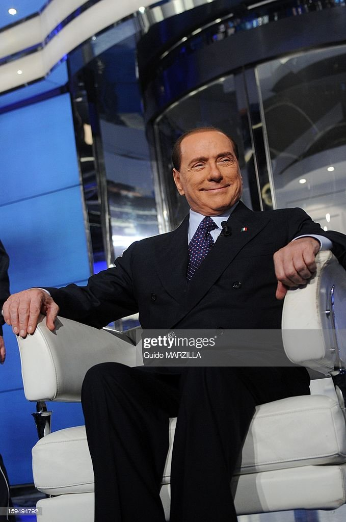 Italy's ex Prime Minister <a gi-track='captionPersonalityLinkClicked' href=/galleries/search?phrase=Silvio+Berlusconi&family=editorial&specificpeople=201842 ng-click='$event.stopPropagation()'>Silvio Berlusconi</a> attends the RAI television show 'Porta a Porta' (Door to Door) in Rome, Italy on January 9, 2013. <a gi-track='captionPersonalityLinkClicked' href=/galleries/search?phrase=Silvio+Berlusconi&family=editorial&specificpeople=201842 ng-click='$event.stopPropagation()'>Silvio Berlusconi</a> withdrew as candidate for Italy's premiership.