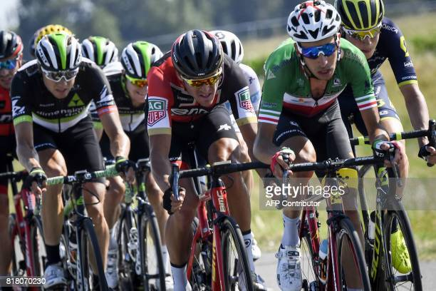 Italy's Fabio Aru Belgium's Greg Van Avermaet and Norway's Edvald Boasson Hagen ride in the pack during the 165 km sixteenth stage of the 104th...