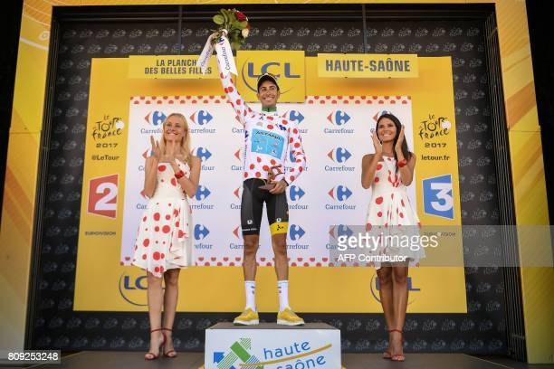 Italy's Fabio Aru celebrates his polka dot jersey of best climber on the podium at the end of the 1605 km fifth stage of the 104th edition of the...