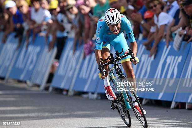 Italy's Fabio Aru crosses the finish line at the end of the 17 km individual timetrial the eighteenth stage of the 103rd edition of the Tour de...