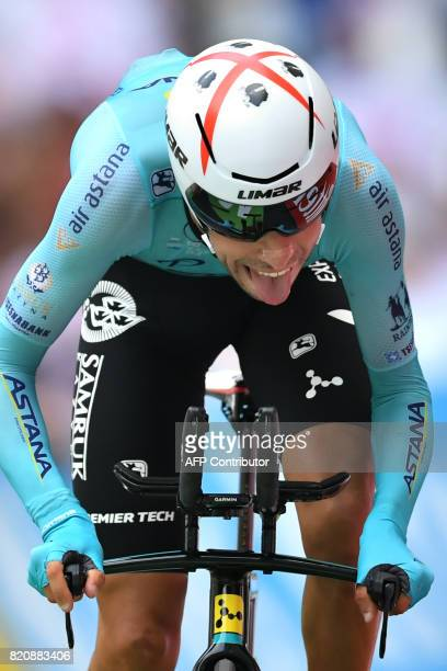 Italy's Fabio Aru crosses the finish line at the Velodrome stadium at the end of a 225 km individual timetrial the twentieth stage of the 104th...