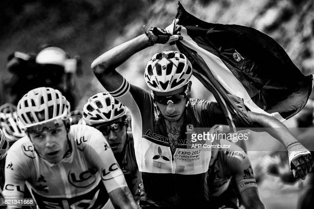 Italy's Fabio Aru rides behind Great Britain's Christopher Froome wearing the overall leader's yellow jersey during the 183 km seventeenth stage of...