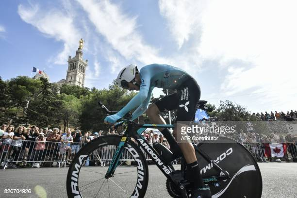 Italy's Fabio Aru rides past the NotreDame de la Garde basilica as he competes in a 225 km individual timetrial the twentieth stage of the 104th...