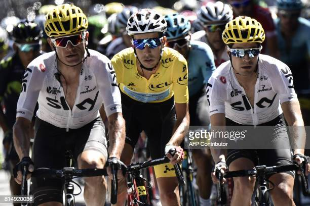 Italy's Fabio Aru wearing the overall leader's yellow jersey rides between Belarus' Vasil Kiryienka and Spain's Mikel Landa during the 1815 km...