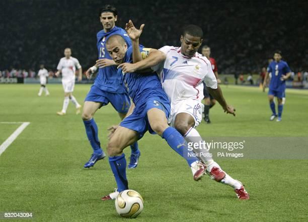 Italy's Fabio Cannavaro and France's Florent Malouda battle for the ball