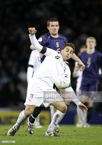 Italy's Fabio Cannavaro and Scotland's Barry Ferguson battle for the ball