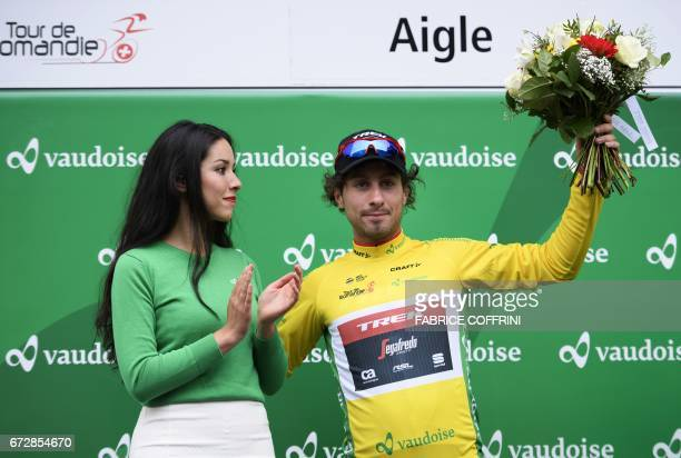 Italy's Fabio Felline of TrekSegafredo team wearing the overall leader yellow jersey celebrates after winning the 48 km prologue of the Tour of...