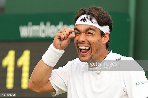Italy's Fabio Fognini gestures as he reacts to a decision during a game against US player Alex Kuznetsov during their men's singles first round match...